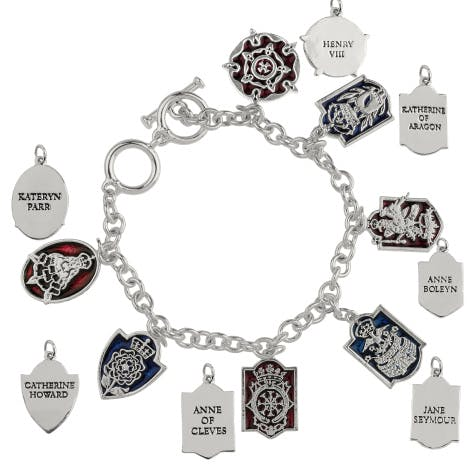 Six Wives Charm Bracelet.  An intriguing royal heraldic charm bracelet with charms of Henry VIII and his six wives family crests.