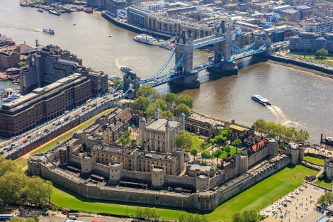 Aerial view of the Tower of London from the north west with Tower Bridge in the distance.