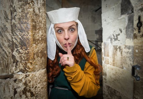 Actor in costume as Medieval Lady-in-Waiting