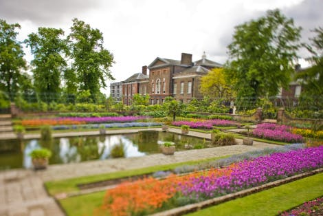 Summer planting in the Sunken Garden 2009.  Special effects creative photography using a tilt-shift lens. This selectively focuses the image and gives a miniaturised effect. This image focuses on Kensington Palace in the background.
