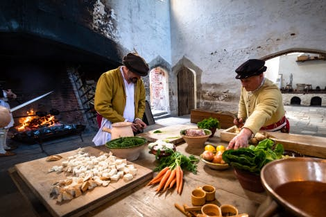 Tudor cooks prepare meals in the Tudor kitchens of Henry VIII at Hampton Court Palace
