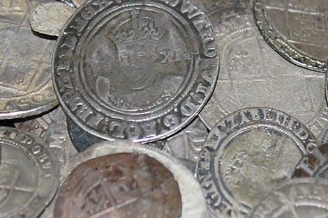 95 silver coins which would have been in circulation in the 1690s.