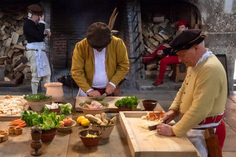 Historic cooks preparing food in Henry VIII's Kitchens