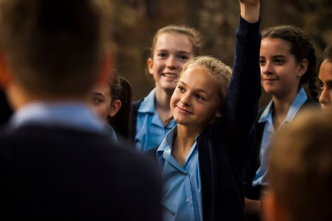 School students attend a tour at Hampton Court Palace in the Tudor apartments.