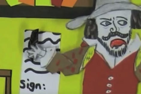 Still from the video 'The Story of Guy Fawkes' depicting Guy Fawkes signing his confession for his participation in the Gunpowder Plot.