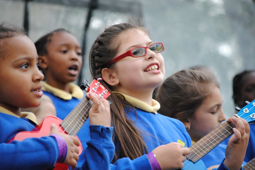 Children playing guitars at the Music at the Tower festival at the Tower of London