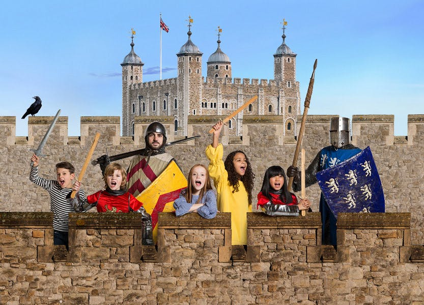 A Knight and children holding swords at the Tower of London