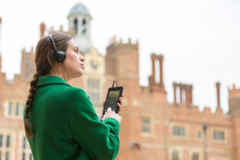 A visitor uses the DVG in Base Court at Hampton Court Palace