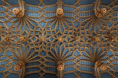 Geometric pattern on the ceiling of the Chapel Royal inlaid with a bright blue background and gold stars.