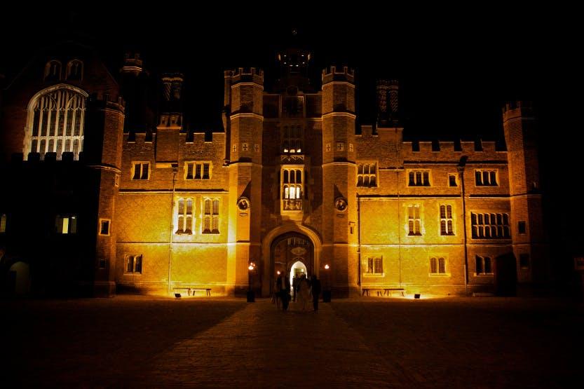 Base Court of Hampton Court Palace illuminated in darkness