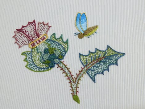 Embroidered thistle and butterfly on a white background