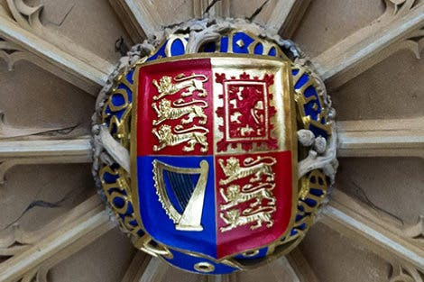 Detail of the Anne Boleyn Archway showing Henry VIII's brightly coloured crest.