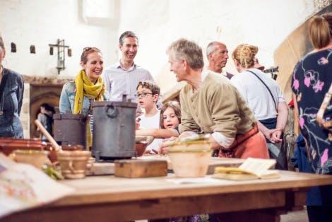 Visitors explore Henry VIII's Kitchens after re-interpretation in 2018.