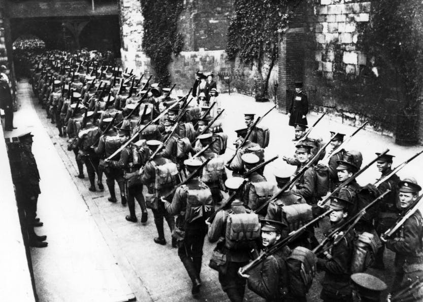 Black and white photograph of soldiers leaving the Tower