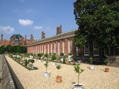 The Lower Orangery garden and terrace, looking north-west towards the Mantegna Gallery. Vine Cottage is in the background on the left of the image.