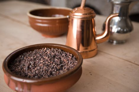 Some equipment and cocoa nibs that would have been seen and used in the Georgian period.