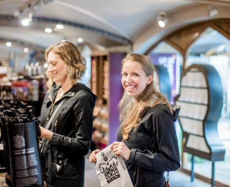 Two female visitors are shown in the Ravens shop.
