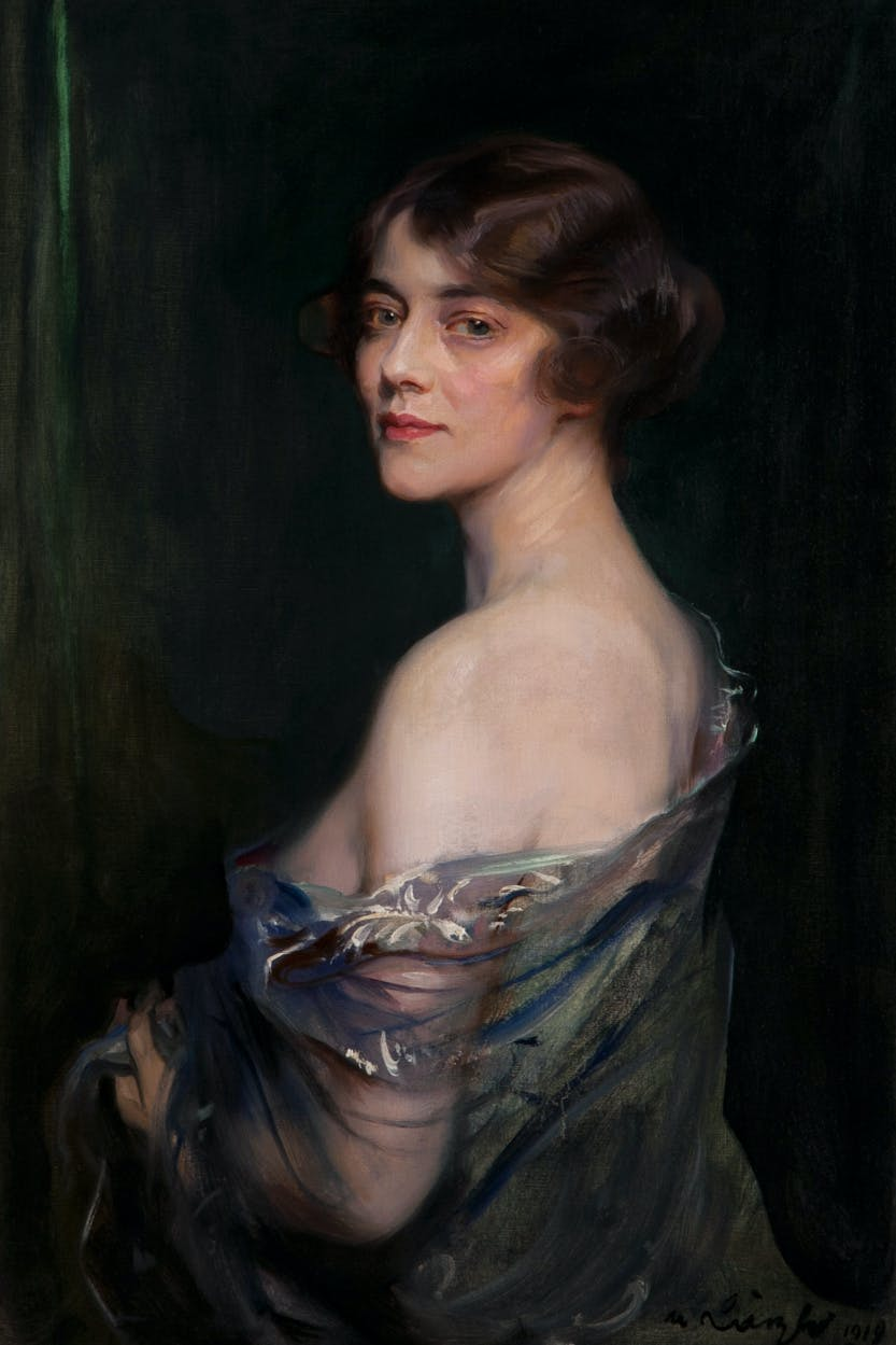 Three quarter length portrait of Evelyn, the Marchioness of Downshire, who is looking over her shoulder towards the viewer.