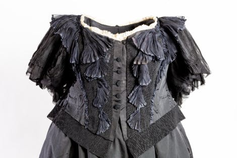 Bodice of Queen Victoria mourning dress. Bodice & skirt, with trained back, of black silk,  crepe & silk chiffon