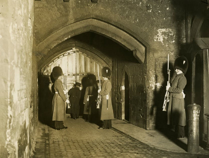 The Ceremony of the Keys. The Chief Yeoman Warder locking the gates of the Byward Tower in 1930.