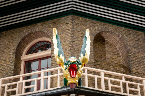 A green and gold dragon on the side of the Great Pagoda at Kew