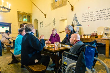 Group of visitors sitting at a table in the café.