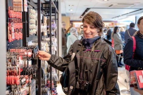 A female visitor looking at merchandise in the Tower shop.