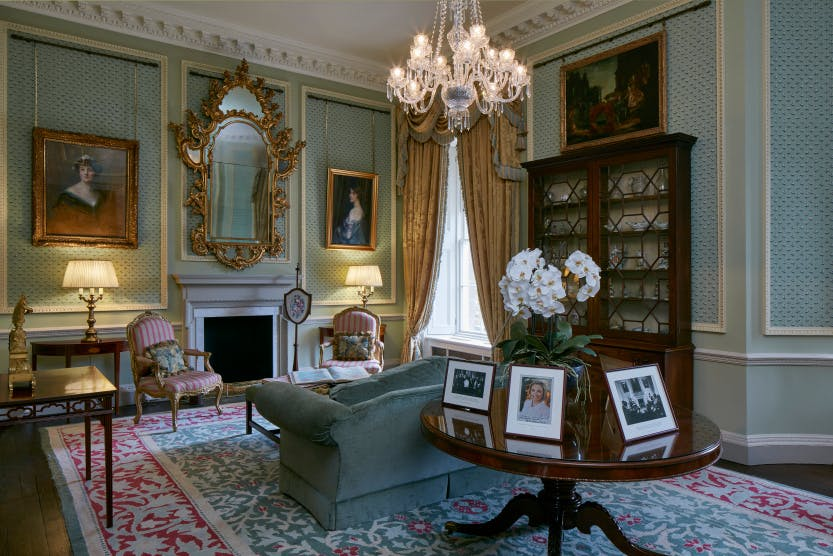Lady Grey's Study, Hillsborough Castle, featuring paintings, furniture, and pastel blue walls.