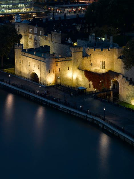 St Thomas's Tower and the Wakefield Tower at the Tower of London, viewed from Tower Bridge at night.