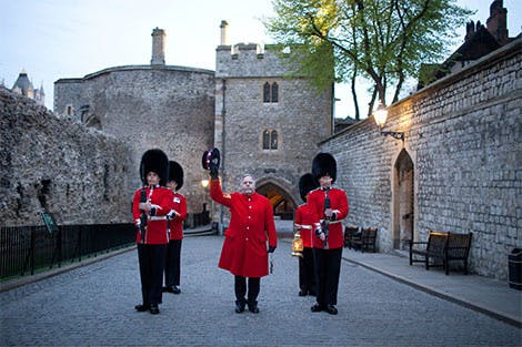 Regimental guards surround the Chief Yeoman Warder as they stand outside the Bloody Tower in the Ceremony of the Keys at the Tower of London