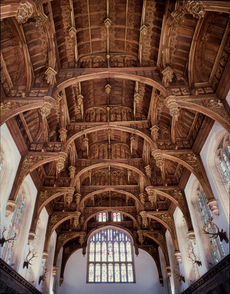 The hammerbeam roof was designed by King Henry VIII's Master Carpenter, James Nedeham, and originally would have been painted with blue, red and gold.