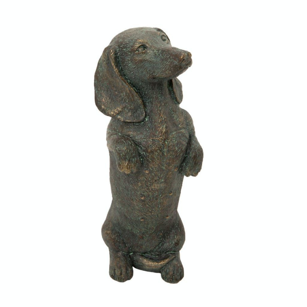 White background. Main image is of a bronze finished garden ornament of a miniature dachshund which is sold in the shops and online.