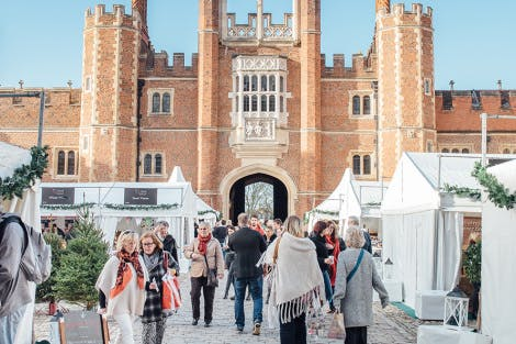 Visitors enjoy the food festival in Base Court at Hampton Court Palace