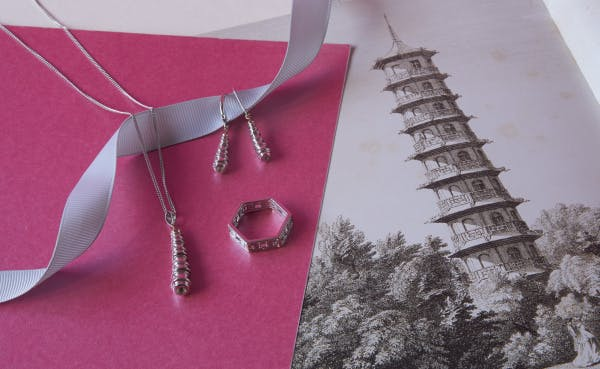 A selection of silver jewellery celebrating the conservation of the Great Pagoda at Kew Gardens.