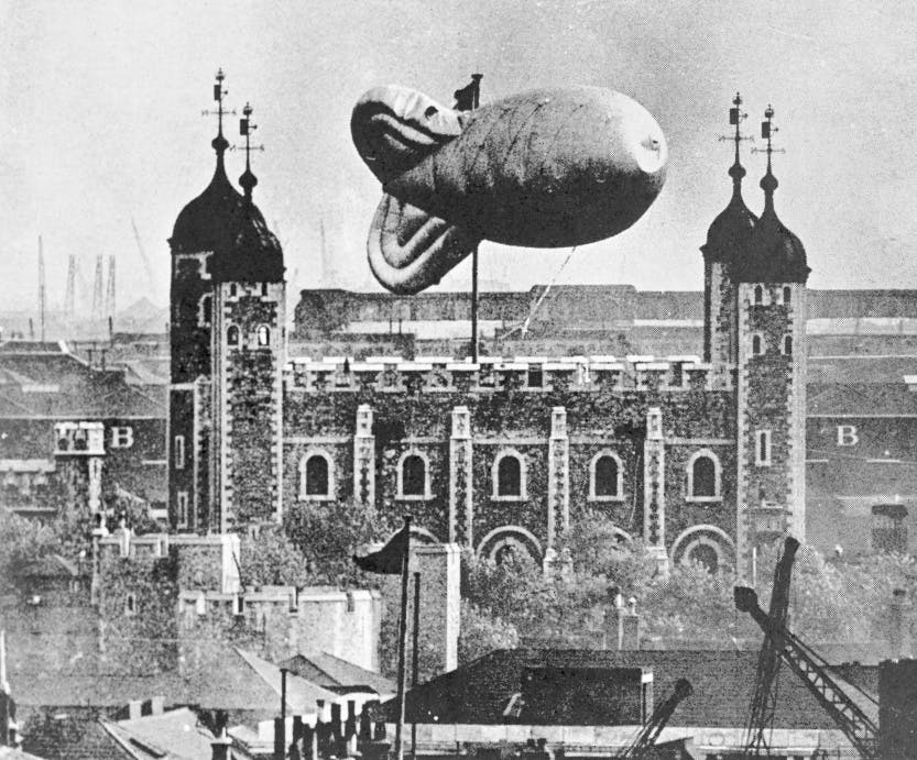 Barrage balloon over Tower of London - black and white photograph.