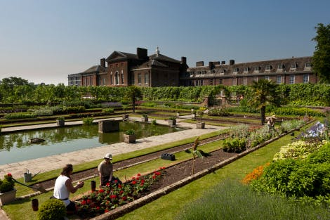 The Sunken Garden after Kensington Palace renovations looking south-west, 28 May 2012. Showing Historic Royal Palaces gardeners planting bedding flowers in the foreground.   Part of the Kensington Palace project, 'Welcome to Kensington - a palace for everyone', an undertaking over two years (2010-12) of major refurbishments (renovation) at Kensington, including new gardens.