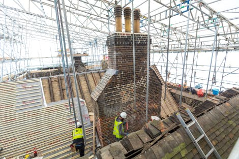 Conservation contractors tending to the Queen's House roof top as part of a larger conservation project to preserve the building