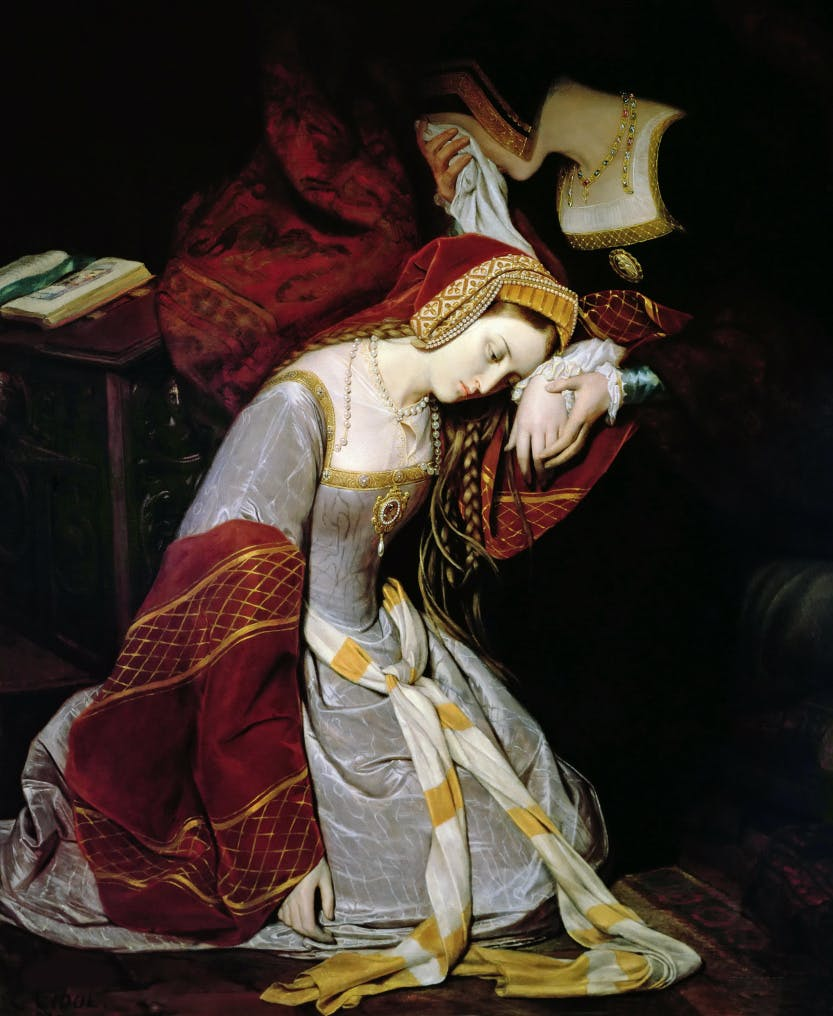 A painting of Anne Boleyn in a dark room in the Tower of London, kneeling and resting her head against her distressed lady-in-waiting, who's face is hidden beneath her handkerchief.