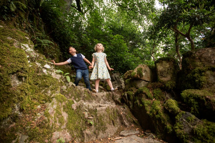 A mother and two children explore the explore the Glen at Hillsborough Castle and Gardens