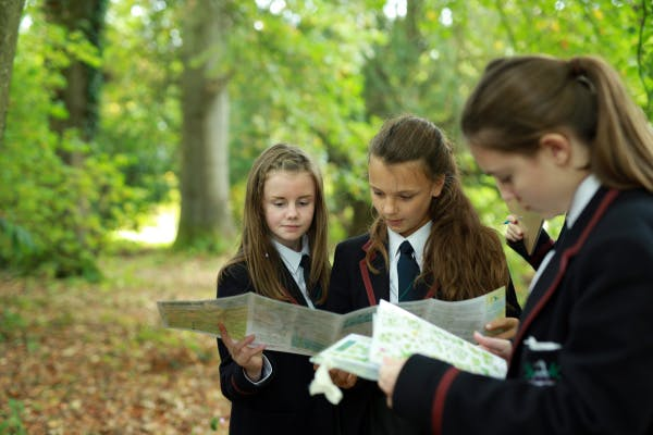 KS3 group engaged in a Geography school session in the gardens at Hillsborough Castle.