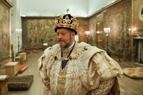 A live interpreter in the role of King Henry VIII at Hampton Court Palace.