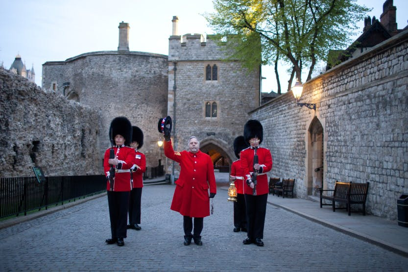 The Chief Yeoman Warder and escort outside the Main Guard at the end of the Ceremony of the Keys at the Tower of London