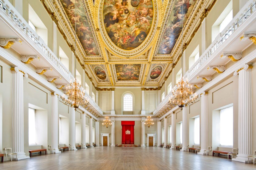 Main Hall of Banqueting House with red canopy of state at the far end