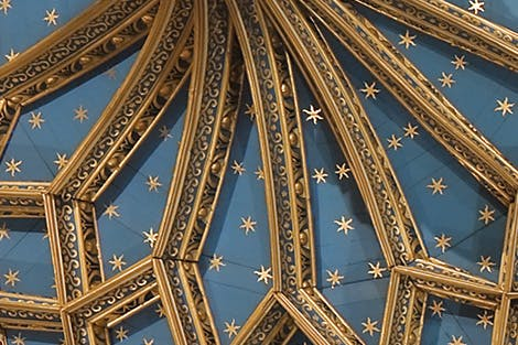 Geometric pattern on the blue ceiling of the Chapel Royal, covered in gold stars.