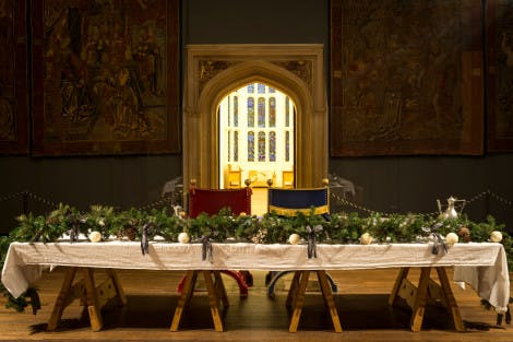 Christmas holly and foliage on the main table in the Great Hall at Hampton Court Palace