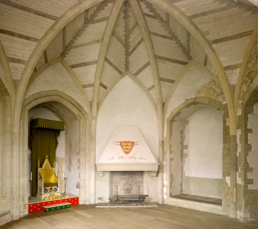 The Wakefield Tower. The Throne Room, looking north west. The replica throne of King Edward I is based on the Coronation Chair in Westminster Abbey.