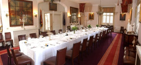 A long table set for dinner guests in the Royal Regiment of Fusiliers space