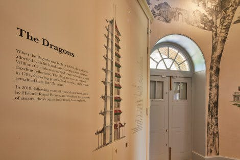 The Great Pagoda ground floor after restoration 3 July 2018. Looking towards the closed doorway and showing interpretation detail, printed directly onto the south-west wall. Showing a diagram of the Great Pagoda and information entitled 'The Dragons' about the 2018 replacement of 80 hand-carved dragons which originally adorned the pagoda.
