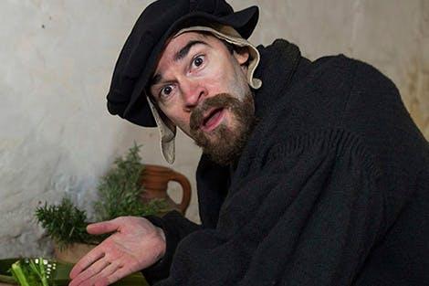 Actor in costume as Kitchen Clerk