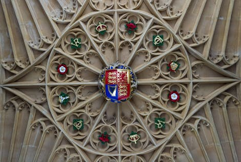 Ceiling at Hampton Court adorned with various colourful symbols